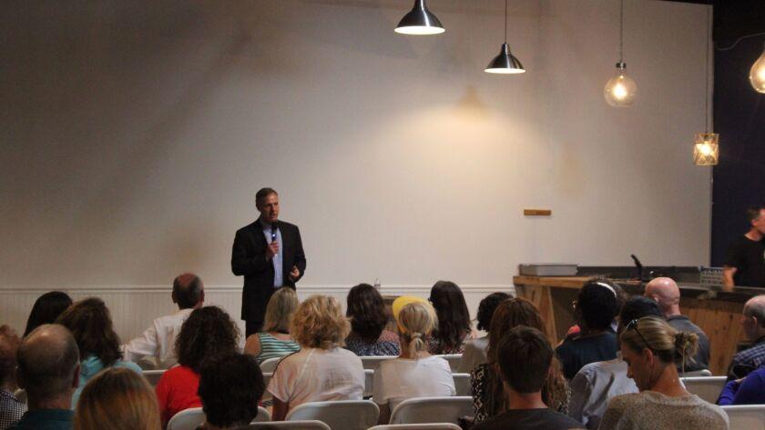 Congressman Scott Peters speaks at New English Brewing.