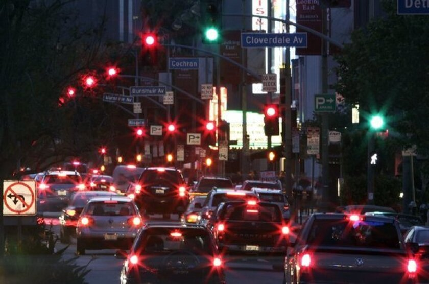 Wilshire Boulevard in Los Angeles last month. Los Angeles completed a 29-year, $410-million effort to synchronize its traffic lights, but some drivers say they haven't noticed much difference.