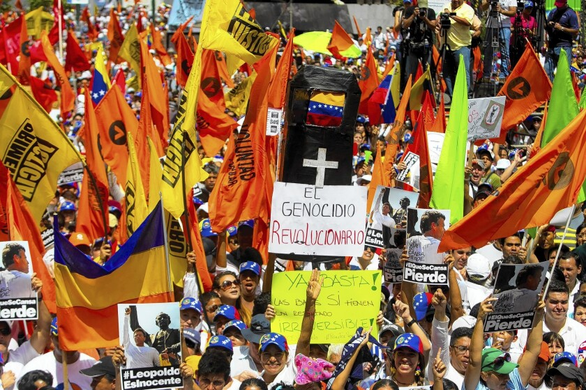 Venezuelans demonstrate against President Nicolas Maduro in Caracas.