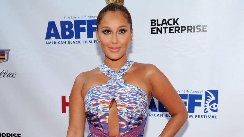 Adrienne Bailon, the singer who previously dated reality star Rob Kardashian, has drawn ire from his family over an interview she gave to Latina magazine.
