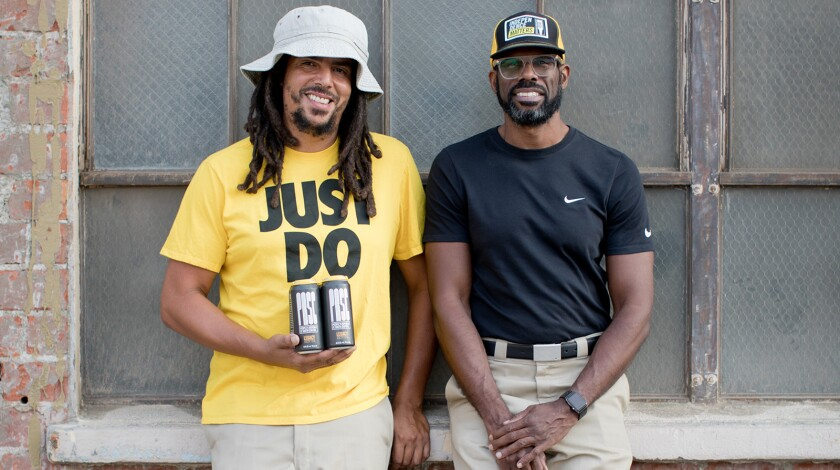 From left, Samuel Chawinga and Craig Bowers, owners of South Los Angeles Beverage Compay.