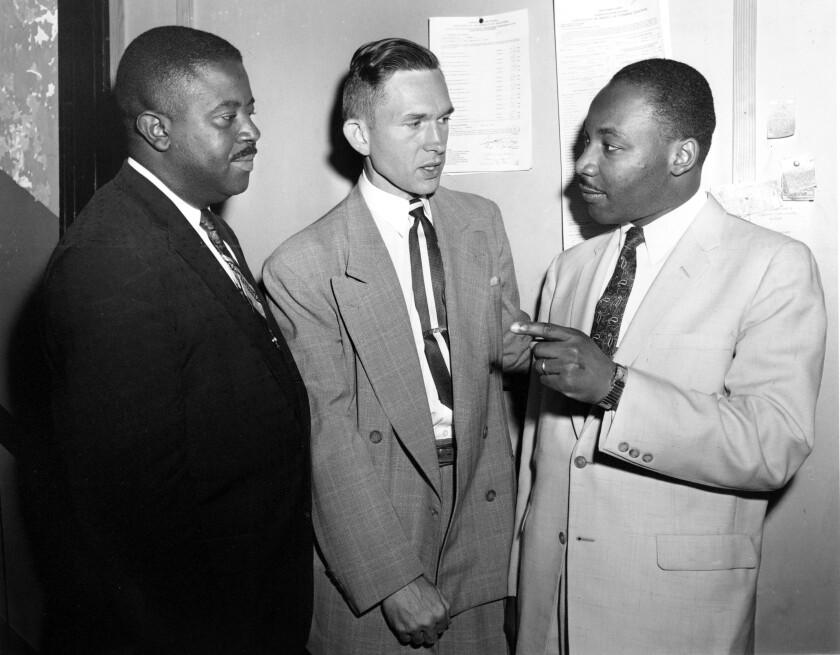 The Rev. Ralph Abernathy, left, Rev. Robert Graetz and Rev. Martin Luther King Jr. talk together.