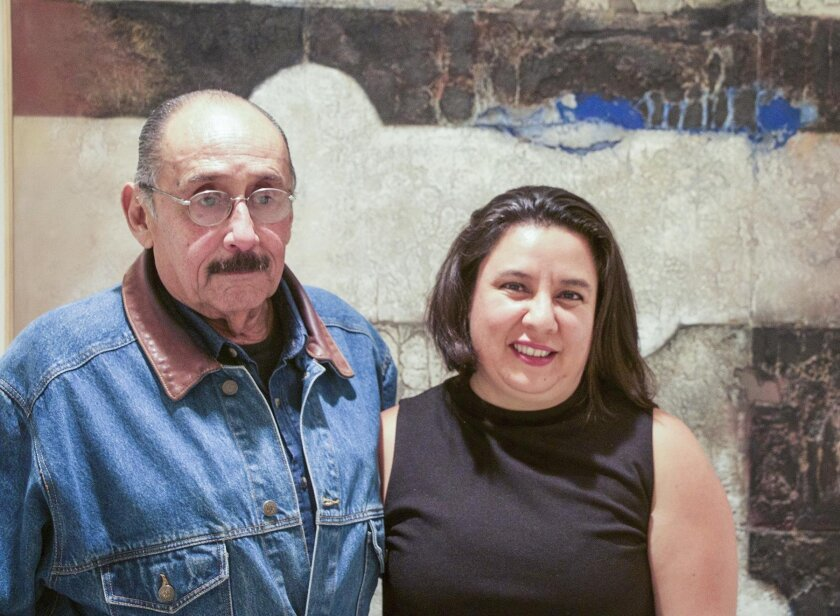 Álvaro Blancarte with Cris Scorza in front of 'Bursting the Blue,' a gift of the artist to MCASD.