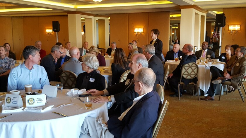 At a recent La Jolla Rotary Club meeting, Cindy Goodman (standing) reports on community service opportunities.