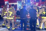 Firefighters rescue unconscious man from burning apartment