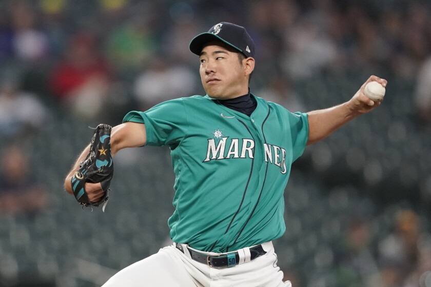 Seattle Mariners starting pitcher Yusei Kikuchi throws to a Tampa Bay Rays batter during the sixth inning of a baseball game Friday, June 18, 2021, in Seattle. (AP Photo/Ted S. Warren)