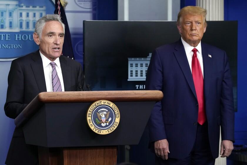 Dr. Scott Atlas speaks as President Trump looks on