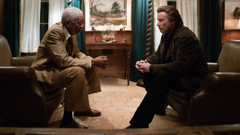 "(L-R)- Morgan Freeman and John Travolta in a scene from ""The Poison Rose."" Credit: Brian Douglas"