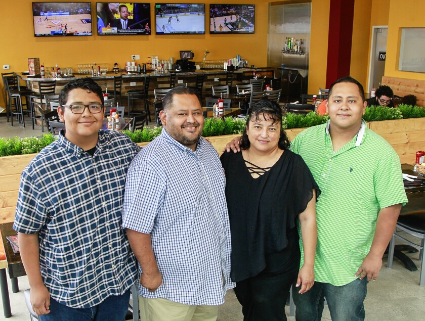 Maggie's Cafe family members (from left) Luis Granda, David Granda, Argelia Granda, and David Granda Jr. make everyone feel like family at this Mexican-inspired comfort food eatery in Barrio Logan.