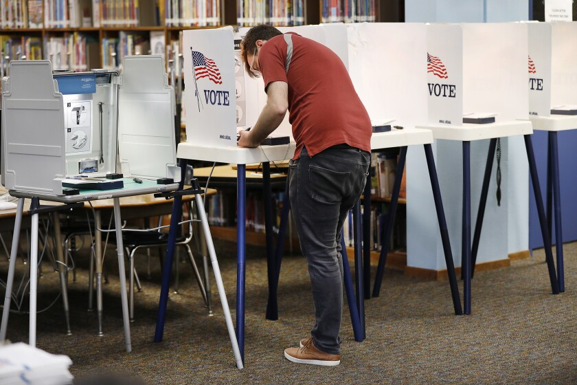 LOS ANGELES, CA – JUNE 05, 2018: Paul Fraser at the voting booth Tuesday morning June 5, 2018 at