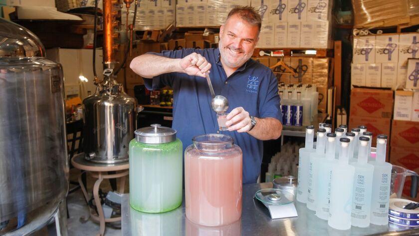 Owner Nick Apostolopoulos serves up 619 Rose Petal Vodka at 619 Spirits Distillery and Tasting Room.