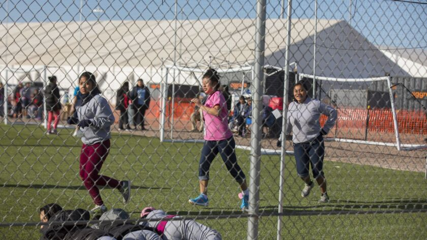 In this Nov. 25, 2018 photo provided by Ivan Pierre Aguirre, migrant teens held inside the Tornillo