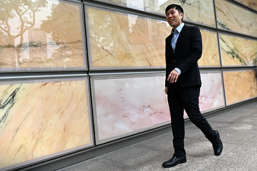 Singaporean activist Jolovan Wham leaves the High Court in Singapore in 2019.