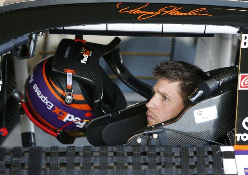 Denny Hamlin waits in his car during practice for Sunday's NASCAR Daytona 500 Sprint Cup series auto race at Daytona International Speedway in Daytona Beach, Fla., Friday, Feb. 19, 2016. (AP Photo/Wilfredo Lee)