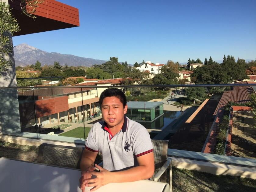 Claremont McKenna College junior Nathaniel Tsai, 19, wrote an open letter taking issue with some of the racial protests on his campus. Here he sits on a roof patio on a deceptively quiet day at school.