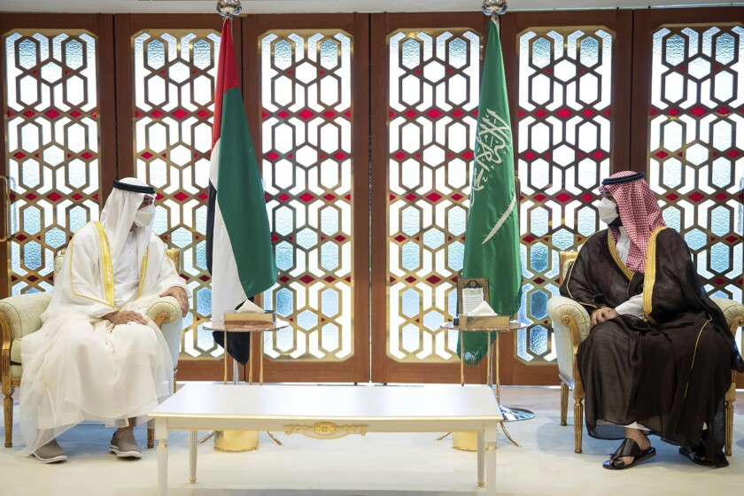 In this handout photograph from the United Arab Emirates' state-run WAM news agency, Abu Dhabi Crown Prince Sheikh Mohammed bin Zayed, left, meets with Saudi Crown Prince Mohammed bin Salman, in Riyadh, Saudi Arabia, Monday, July 19, 2021. The meeting follows weeks of speculation about the growing rift between the two leaders as their nations compete for business, regional investments and prominence. (Rashed Al Mansoori/UAE Ministry of Presidential Affairs/WAM via AP)