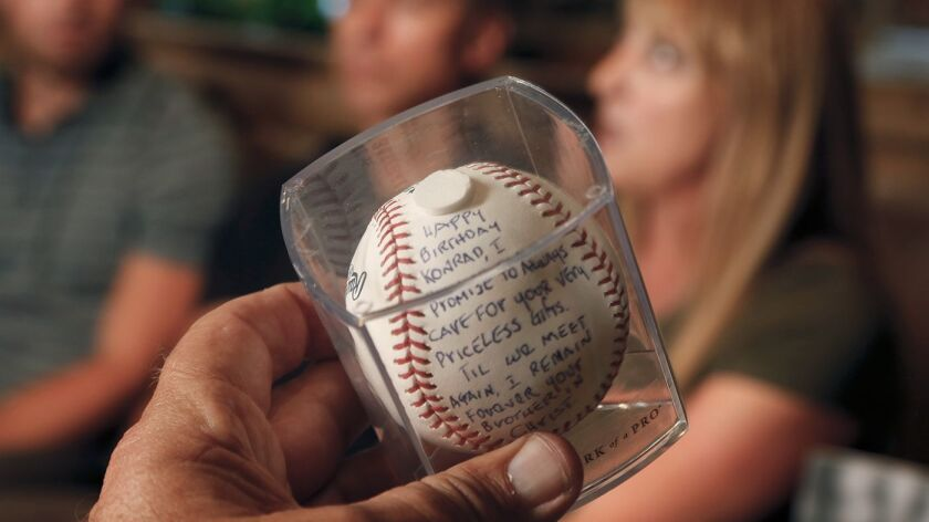 Rod Carew left a signed baseball with a message for Reuland and his family on Konrad Reuland's grave