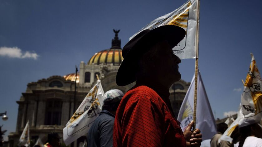 Peasants march in Mexico City, Mexico,calling for the abolition of the agricultural chapter of the N