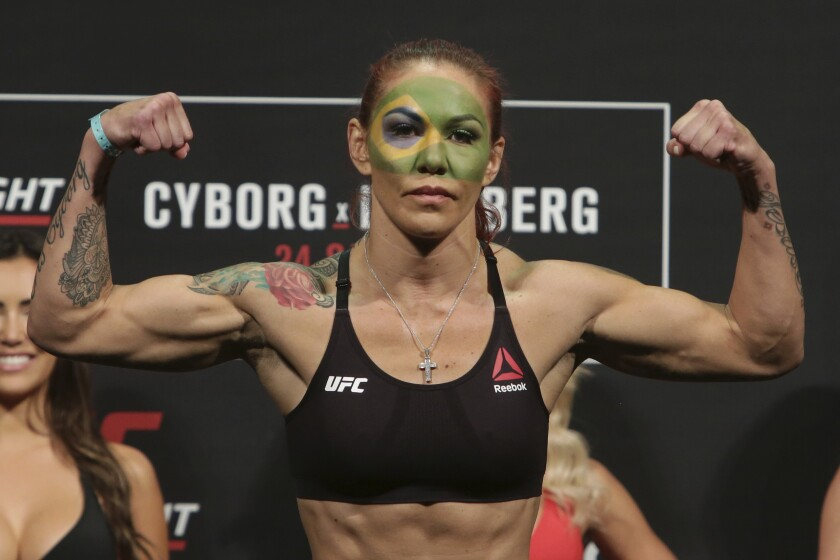 "FILE - In this Sept. 23, 2016, file photo, Brazil's Cristiane Justino, known as ""Cris Cyborg,"" poses during the weigh-in for her UFC Fight Night in Brasilia, Brazil. The U.S. Anti-Doping Agency has cleared UFC featherweight Justino on Friday, Feb. 17, 2017, of a potential policy violation, ending her suspension. (AP Photo/Eraldo Peres, File)"