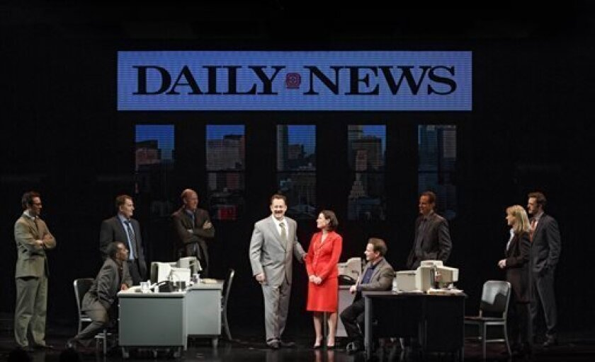 """This theater image released by Boneau/Bryan-Brown shows Tom Hanks as tabloid columnist Mike McAlary, center left, during a performance of """"Lucky Guy,"""" playing at the  Broadhurst Theatre in New York.  (AP Photo/Boneau/Bryan-Brown, Joan Marcus)"""