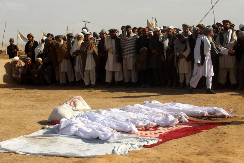 Relatives attend the funeral of Afghan children who were killed in NATO airstrikes in Kunduz, Afghanistan, on Nov. 4, 2016.
