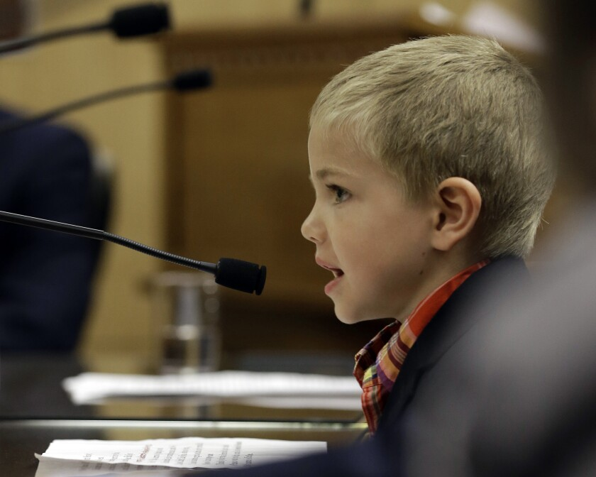 Rhett Krawitt, 7, who could not be vaccinated while he was being treated for leukemia, speaks to lawmakers in April in support of a bill requiring more children to be vaccinated.
