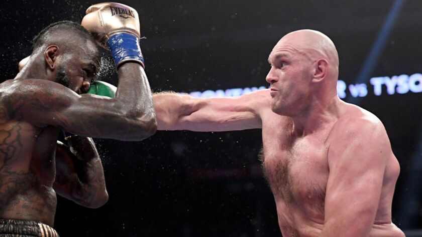 Tyson Fury punches Deontay Wilder during their fight to a draw in December at Staples Center.