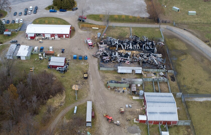 An aerial photo shows the barn that caught fire at African Safari Wildlife Park in Port Clinton, Friday, November 29, 2019. At least 10 animals were killed in the barn fire Thursday at the African Safari Wildlife Park in Port Clinton, Ohio. (Andy Morrison/The Blade via AP)