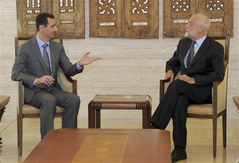 In this photo released by the Syrian official news agency SANA, Syrian President Bashar Assad, left, meets with International Committe of the Red Cross President Jakob Kellenberger, right, in Damascus, Syria, Monday Sept. 5, 2011. Syrian soldiers raided homes and made arrests Monday in a manhunt for an attorney general who appeared on video last week saying he had defected from President Bashar Assad's regime to protest a violent government crackdown on dissent, activists said. (AP Photo/SANA) EDITORIAL USE ONLY