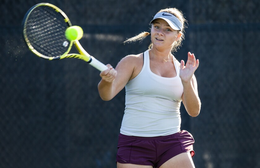 Laguna Beach High freshman  Jessica MacCallum is shown practicing at the Racquet Club of Irvine on Tuesday.