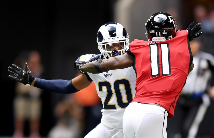 New Rams cornerback Jalen Ramsey keeps tight coverage on the Falcons' Julio Jones.