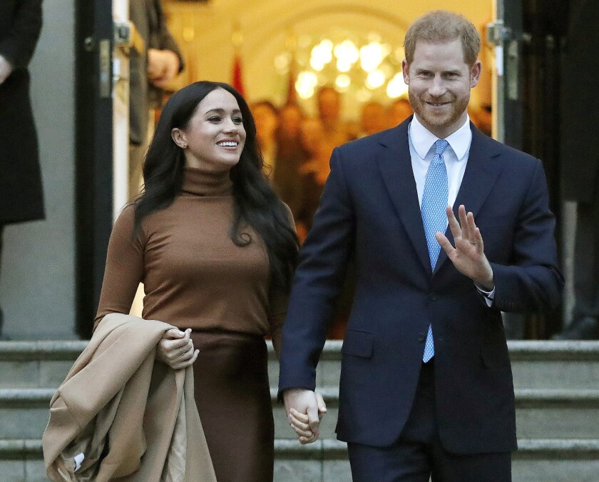 FILE - In this Jan. 7, 2020, file photo, Britain's Prince Harry and Meghan, Duchess of Sussex leave Canada House in London. Six months after detangling their work lives from the British royal family, the couple have signed a multiyear deal with Netflix. According to a statement Wednesday, they plan to produce nature series, documentaries and children's programming through a new production company. The two recently relocated to Santa Barbara, California, with baby Archie. (AP Photo/Frank Augstein, File)