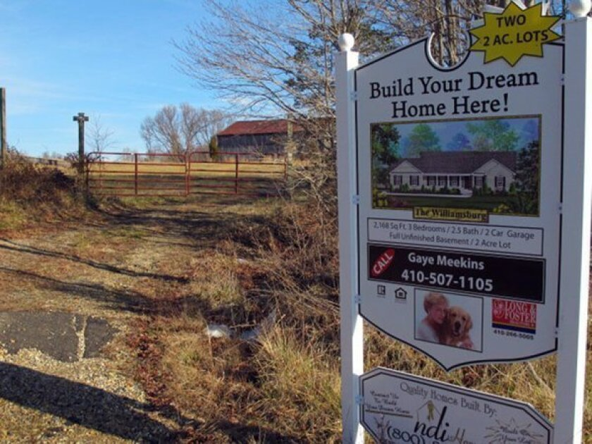 A sign advertising lots for sale to build luxury homes in Deale, Md., near Chesapeake Bay.