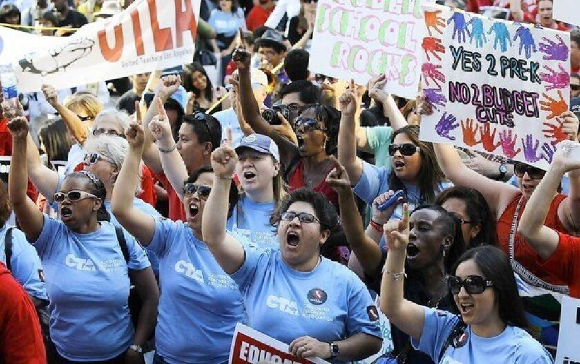 California Teachers Assn. members join others at Pershing Square in downtown Los Angeles to protest budget cuts to statewide education. The union holds sway over Democrats -- labor's traditionally ally --and Republicans alike.