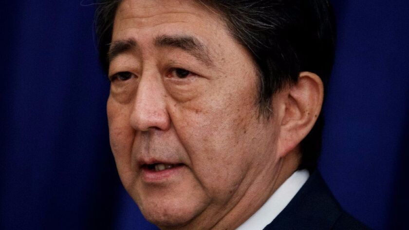 Japanese Prime Minister Shinzo Abe speaks at a luncheon during the United Nations General Assembly.