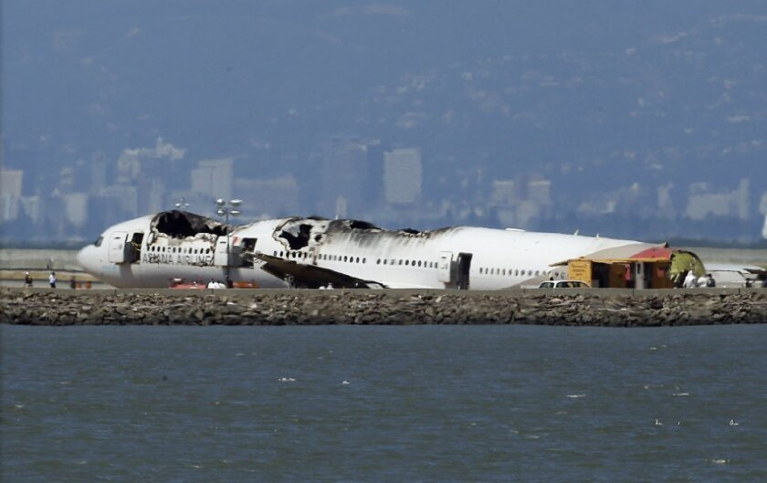 The wreckage of Asiana Airlines Flight 214 in San Francisco.