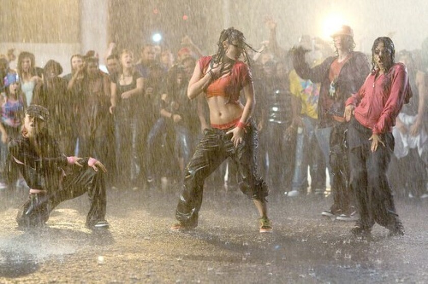 """Briana Evigan, left, Adam G. Sevani and Danielle Polanco show off their moves during the climactic street dance competition in """"Step Up 2 the Streets."""""""