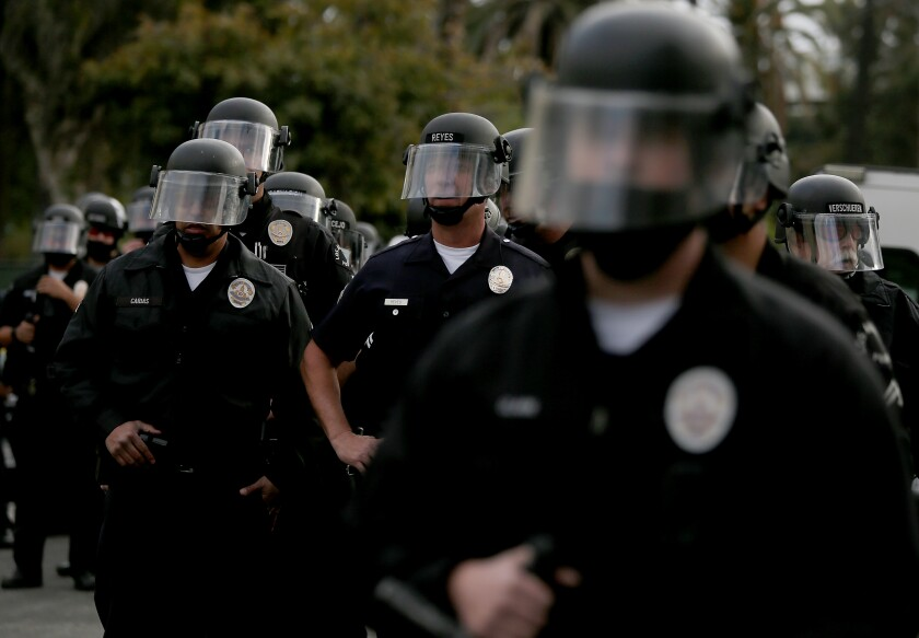 Los Angeles police officers wearing helmets with face shields