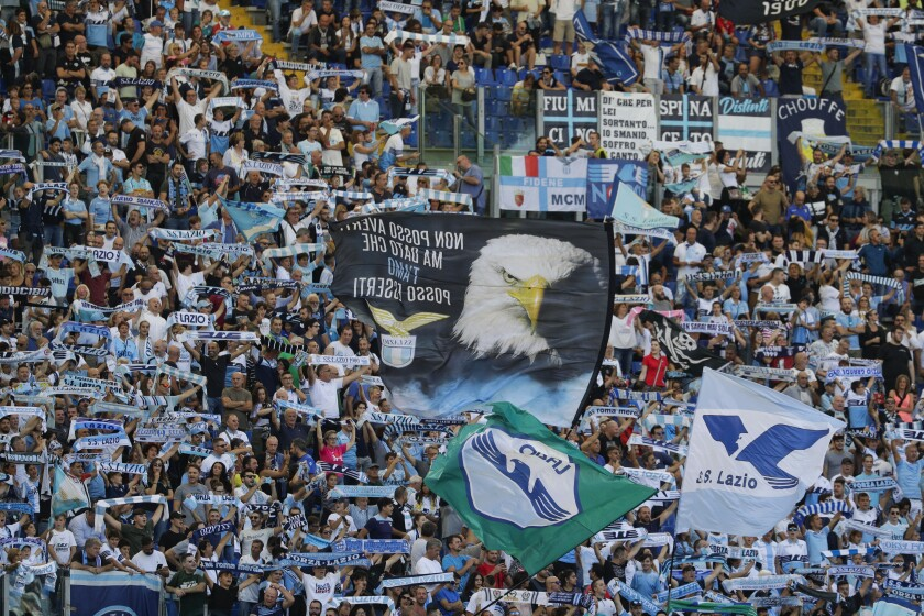 Lazio fans cheer during a Serie A soccer match between Lazio and Genoa, at the Rome Olympic Stadium, Sunday, Sept. 29, 2019. (AP Photo/Andrew Medichini)