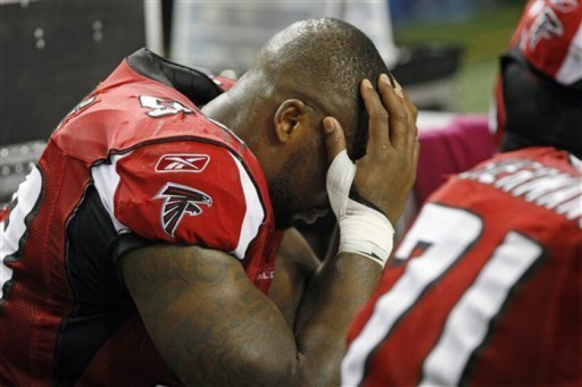Atlanta Falcons defensive end Ray Edwards sits on the bench during the final seconds of a 25-14 loss to the Green Bay Packers in their NFL football game, Sunday, Oct. 9, 2011, in Atlanta. (AP Photo/Atlanta Journal-Constitution, Curtis Compton)