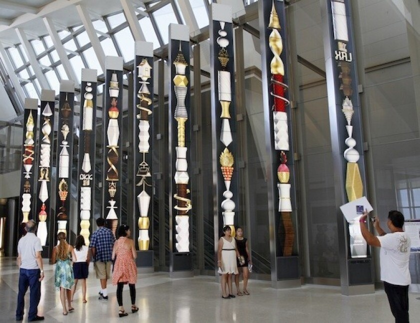 North concourse portals at the Tom Bradley International Terminal at LAX feature 28-foot high columns of vertical stacked monitors displaying changing artwork.