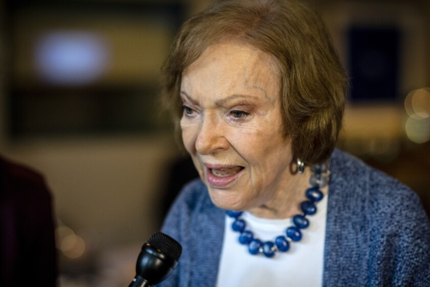 The former first lady Rosalynn Carter speaks to the press at conference at The Carter Center, Tuesday, Nov. 5, 2019, in Atlanta. Carter enjoyed a light lunch in the audience as a panel discussion led by Judy Woodruff, anchor of PBS NewsHour, took center stage. The former First Lady made remarks about her upbringing as a caregiver and the health of her husband, former President Jimmy Carter. (AP Photo/ Ron Harris)