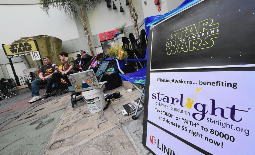 "People camp out in front of the TCL Chinese Theater in Hollywood ahead of the first showing of Star Wars: the Force Awakens"" the night of Dec. 17."
