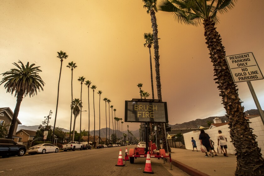 Smoke loomed over Azusa on Wednesday as the Bobcat fire burned in the Angeles National Forest.