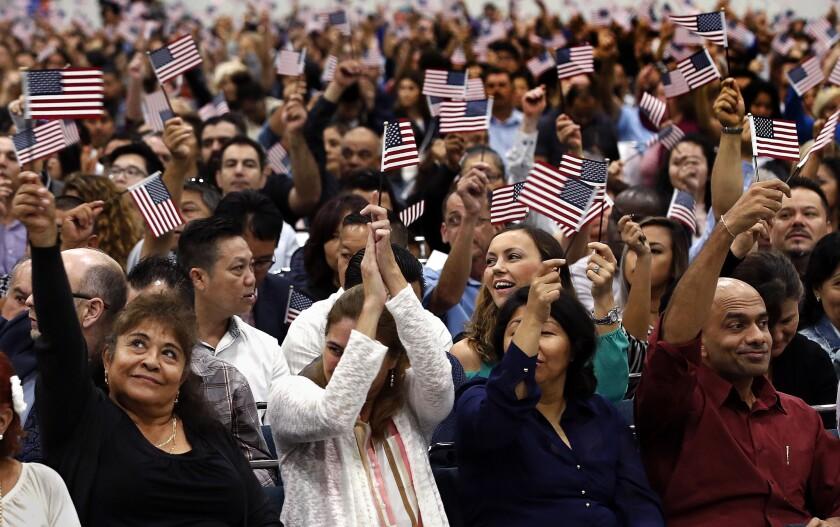 LOS ANGELES, CA-SEPTEMBER 20 2017: Maria Zaragoza, left, originally from Mexico, waves the American