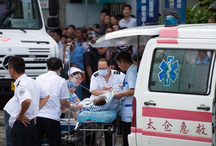 A victim of a factory explosion is wheeled into a hospital in Kunshan, China, on Saturday.