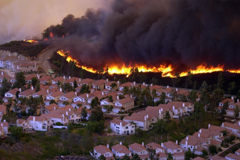 The a wall of fire surrounds Scripps Ranch during the Cedar Fire.