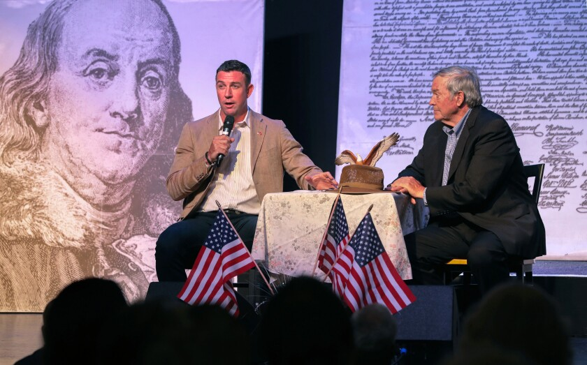Congressman Duncan Hunter, at left, and his father, retired Congressman Duncan Hunter speak about border issues at their town hall meeting at the Ramona Mainstage theater.