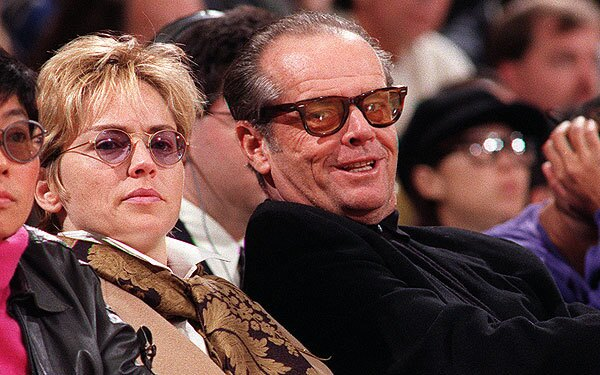 Actress Sharon Stone and Jack Nicholson keep their eyes on the Lakers during a game against the Denver Nuggets at the Forum in 1996.