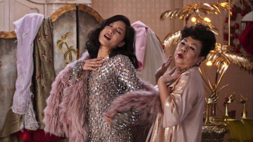 """Constance Wu, left, and Koh Chieng Mun star in """"Crazy Rich Asians."""" The romantic comedy is based on the bestselling novel by Kevin Kwan about a Chinese American woman who learns her boyfriend hails from one of Singapore's wealthiest families."""